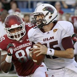 Arkansas defensive end Trey Flowers (86) pressures Louisiana Monroe quarterback Kolton Browning (15) during the first quarter of an NCAA college football game in Little Rock, Ark., Saturday, Sept. 8, 2012.