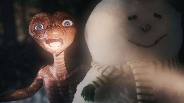 et the extraterrestrial screams from behind a snowman