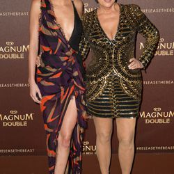 Kendall Jenner wears Versace with Kris Jenner in Balmain at a party for Magnum Double.