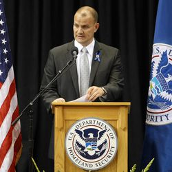 TSA Federal Security Director Darby LaJoye delivers remarks during the public memorial service for slain TSA officer Gerardo Hernandez, Tuesday, Nov. 12, 2013. Hernandez was the first TSA officer killed in the line of duty when a gunman pulled a rifle from a bag and shot the 39-year-old father of two on Nov. 1, at Los Angeles International Airport. Two TSA officers and a teacher were injured before airport police wounded the gunman, Paul Ciancia.