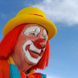 """In this March 29, 2012, photo, Floyd """"Creeky"""" Creekmore poses for a photo after a visit with children at a circus in Billings, Mont. Guinness World Records has anointed the world's oldest performing clown, and it's none other than Creekmore, a former Montana rancher who's been donning the big nose and bright makeup for almost eight decades."""