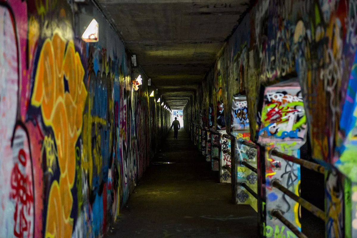 The graffit-covered tunnel, as seen from the inside sidewalk.