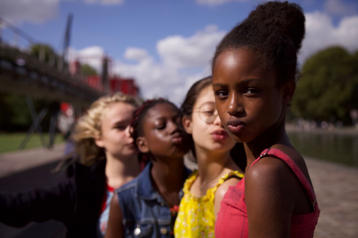 """This image released by Netflix shows the cast of the coming-of-age film """"Cuties."""" The backlash to the French independent film """"Mignonnes,"""" or """"Cuties,"""" started before it had even been released because of a poster that went viral for its provocative depiction of its young female actors."""