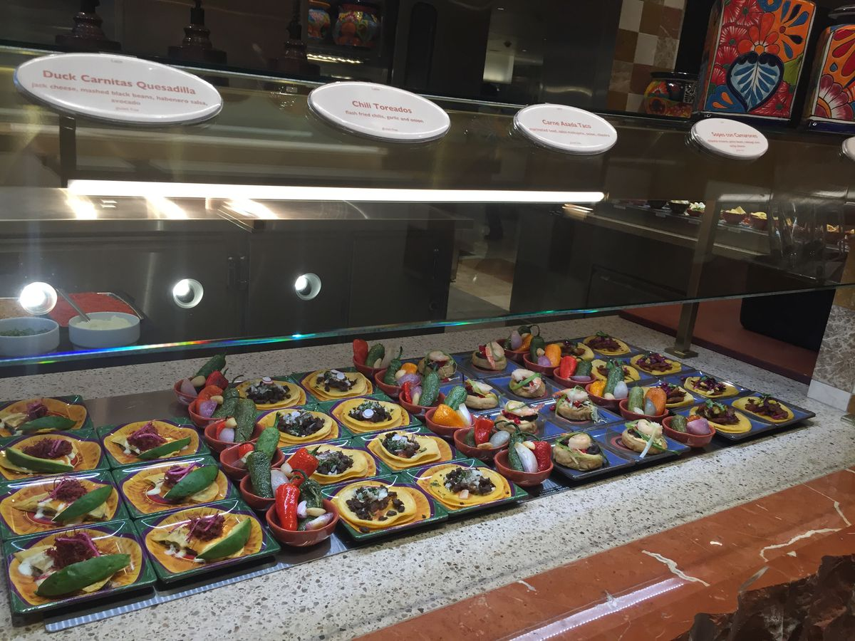Tacos on plates at a buffet