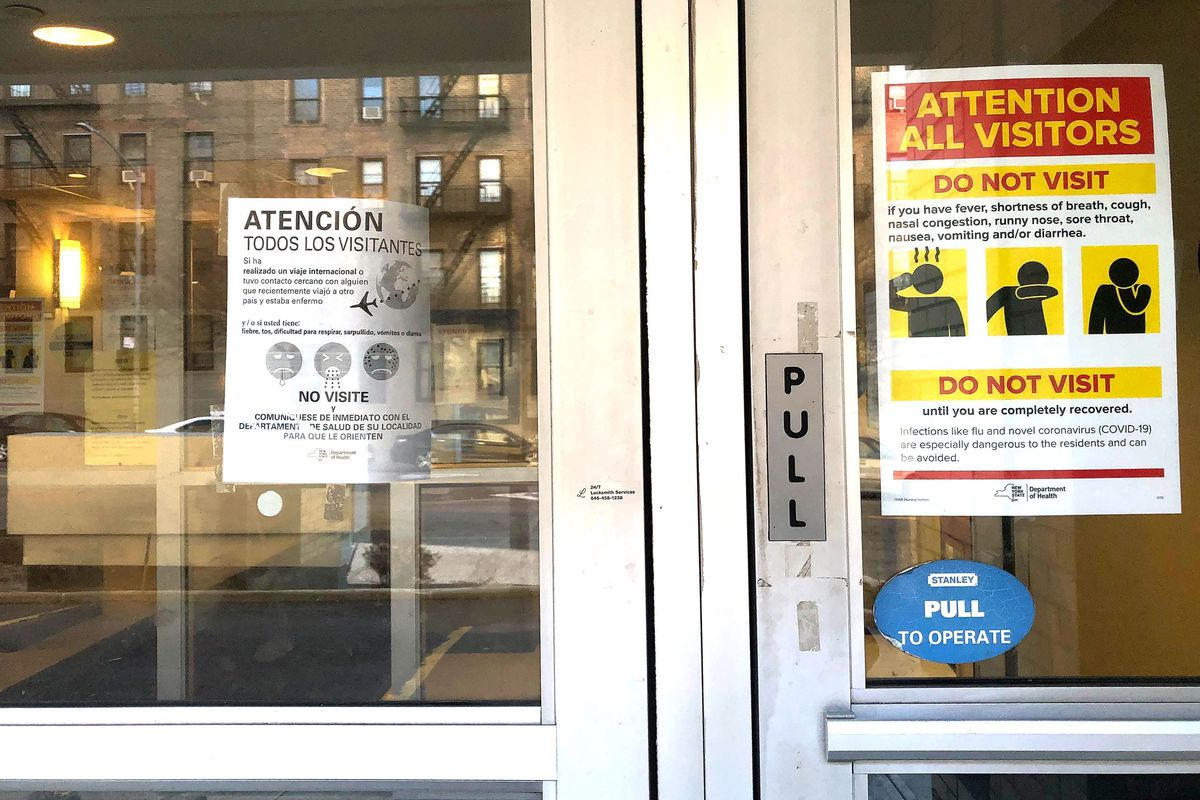 A sign warns against those possibly infected with the coronavirus from visiting the Isabella Geriatric Center in Inwood, Manhattan.