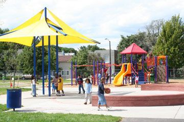 Having something to provide shade is a critical element of a successful playground, Lois Brink says. Here, colorful canopies provide shade at the Wyman Elementary School playground.
