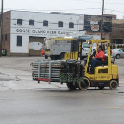 Forklift carrying supplies on Addison -