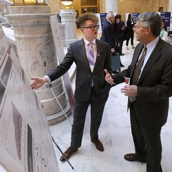 University of Utah student Andrew Smith talks to Sen. Wayne Harper, R-Taylorsville, about his research on chemoselective macrocyclization of linear peptides during Undergrad Research Day at the Capitol in Salt Lake City on Tuesday, Feb. 18, 2020.