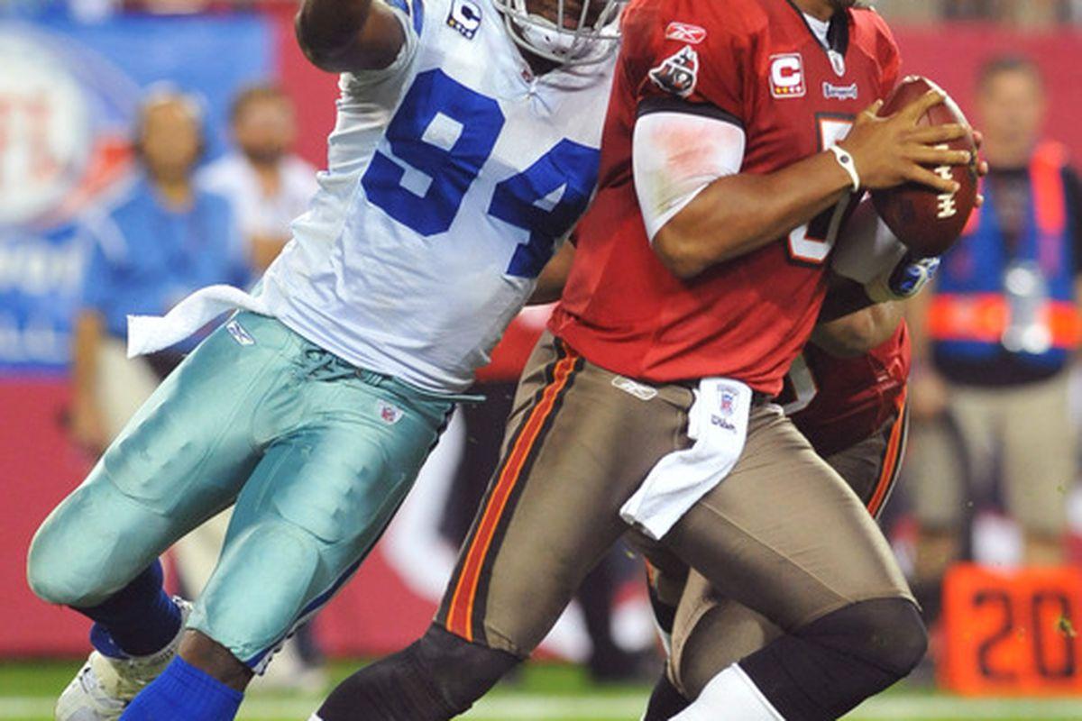 TAMPA, FL - DECEMBER 17:  Linebacker DeMarcus Ware #94 of the Dallas Cowboys sacks quarterback Josh Freeman #5 of the Tampa Bay Buccaneers December 17, 2011 at Raymond James Stadium in Tampa, Florida. (Photo by Al Messerschmidt/Getty Images)