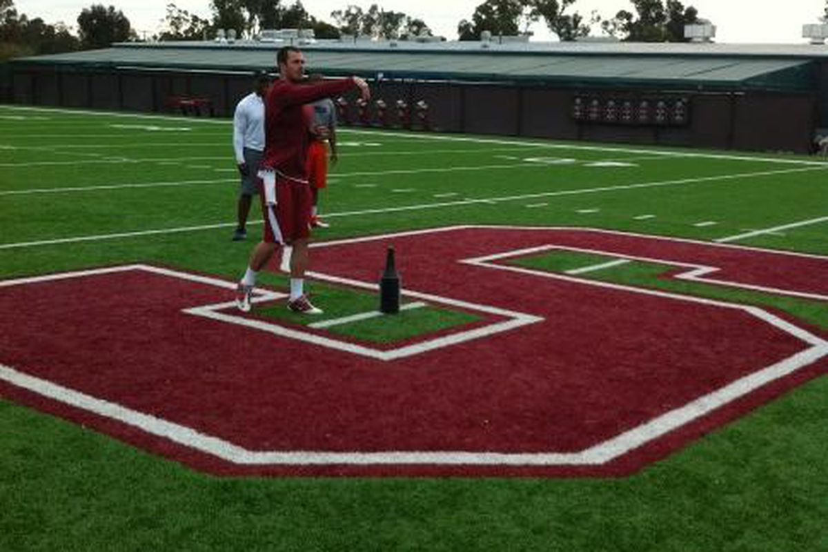 Oklahoma quarterback Landry Jones works out with George Whitfield in Palo Alto, California