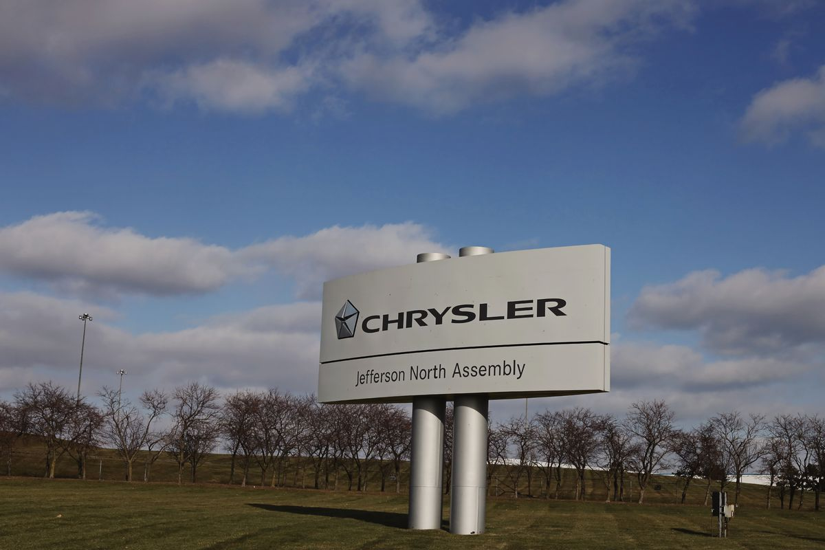 A big sign in an open field that says Chrysler Jefferson North Assembly.