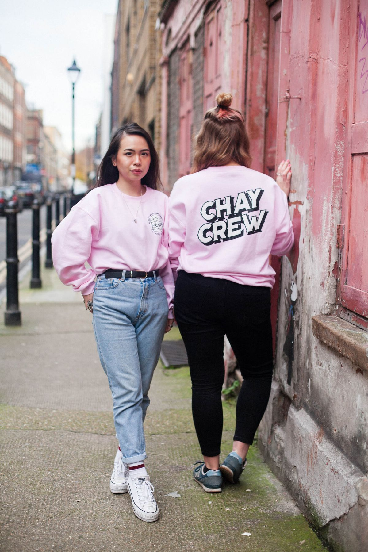 """The best London restaurant merch to buy right now includes this pink jumper with """"CHAY CREW"""" written on the back in all-caps from Eat Chay"""
