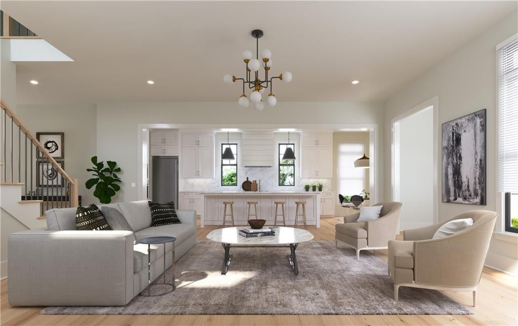 A rendering of a large white space with a kitchen and living room.