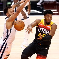 Utah Jazz guard Donovan Mitchell (45) no look passes with Memphis Grizzlies forward Kyle Anderson (1) defending as the Utah Jazz and the Memphis Grizzlies play in game 5 at Vivint Arena in Salt Lake City on Wednesday, June 2, 2021. Utah won 126-110, Utah advances to the second round.