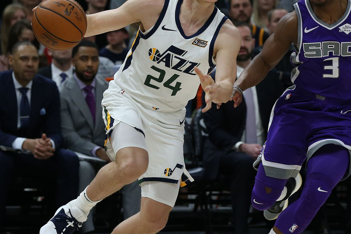Utah Jazz guard Grayson Allen (24) drives past Sacramento Kings guard Yogi Ferrell (3) at Vivint Smart Home Arena in Salt Lake City on Friday, April 5, 2019. Allen scored 19 points during the first half.