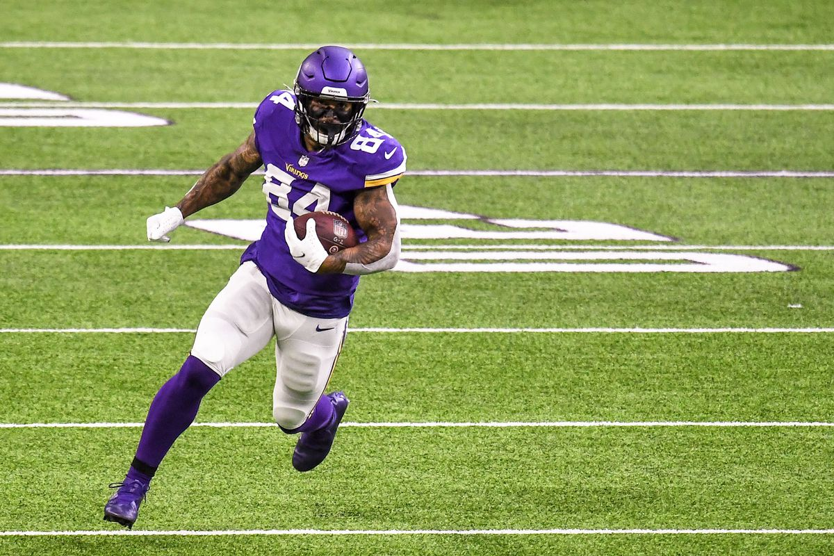 Minnesota Vikings tight end Irv Smith Jr. runs with the ball after a catch for a 36-yard gain in the first quarter against the Atlanta Falcons at U.S. Bank Stadium.