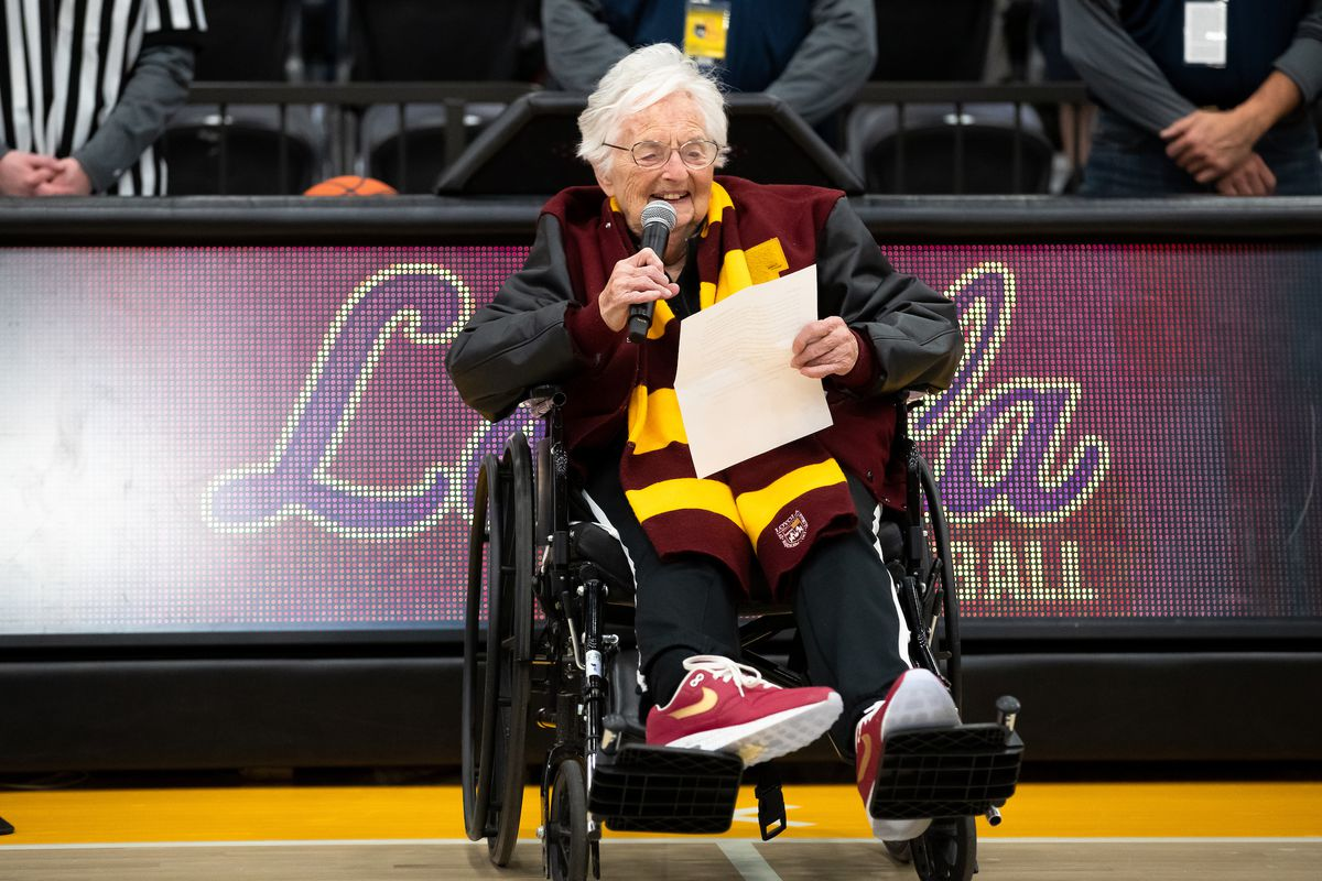 Sister Jean sits in her wheelchair wearing a striped scarf that sports Loyola's school colors, maroon and gold. Due to the pandemic, Sister Jean said she has had to turn on her radio to listen to play-by-plays of the Ramblers' games for most of the season.