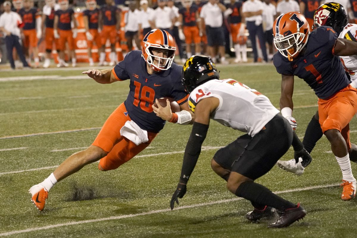 Illinois quarterback Brandon Peters makes a cut as Maryland defensive back Nick Cross comes up to make a tackle during the Sept. 17 game.