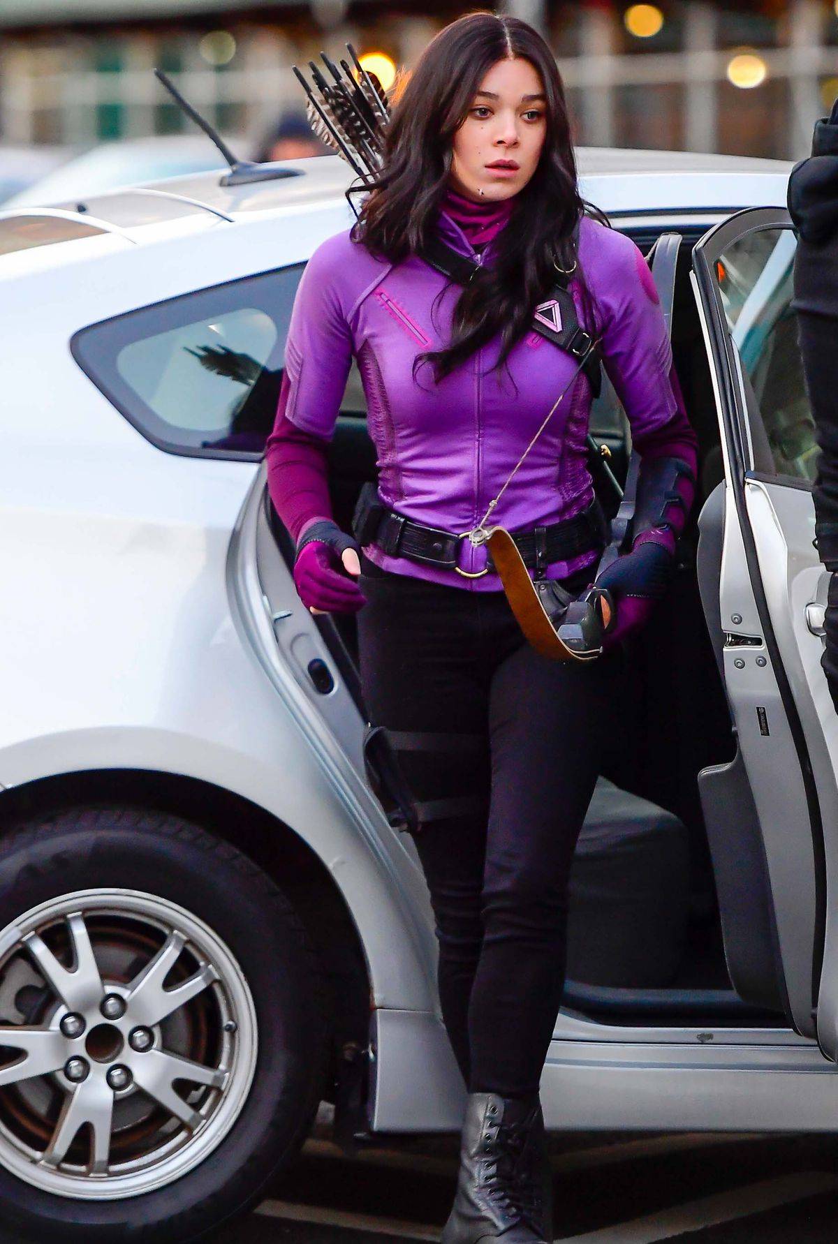 Hailee Steinfeld as Kate Bishop in marvel's Hawkeye series stepping out of a car in New York City