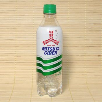 A clear bottle with a green and white label.