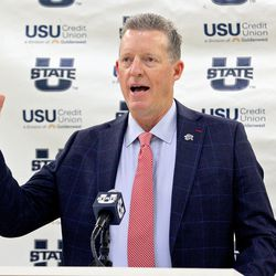 Utah State athletic director John Hartwell introduces new men's head basketball coach Ryan Odom on Wednesday, April 7, 2021, at the Wayne Estes Center in Logan.