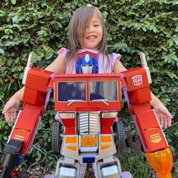 My daughter is much taller than Optimus but she wanted this picture.