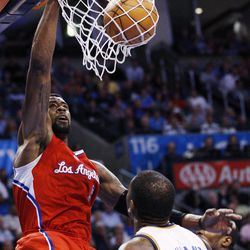Los Angeles Clippers center DeAndre Jordan, left, dunks in front of Oklahoma City Thunder forward Kevin Durant (35) in the first quarter of an NBA basketball game in Oklahoma City, Wednesday, April 11, 2012.