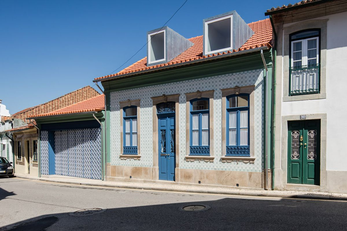 Streetfront house with patterned facade and garage.