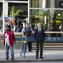 Chicago Police guard the Israeli Consulate, where hundreds marched to protest the U.S. embassy in Israel move from Tel Aviv to Jerusalem, and violent bloodshed during protests on the Gaza border, Tuesday afternoon, May 15, 2018. The protest comes one day after Israeli soldiers shot and killed 59 Palestinians and wounded more than 1,300 in the mass protests. | Ashlee Rezin/Sun-Times
