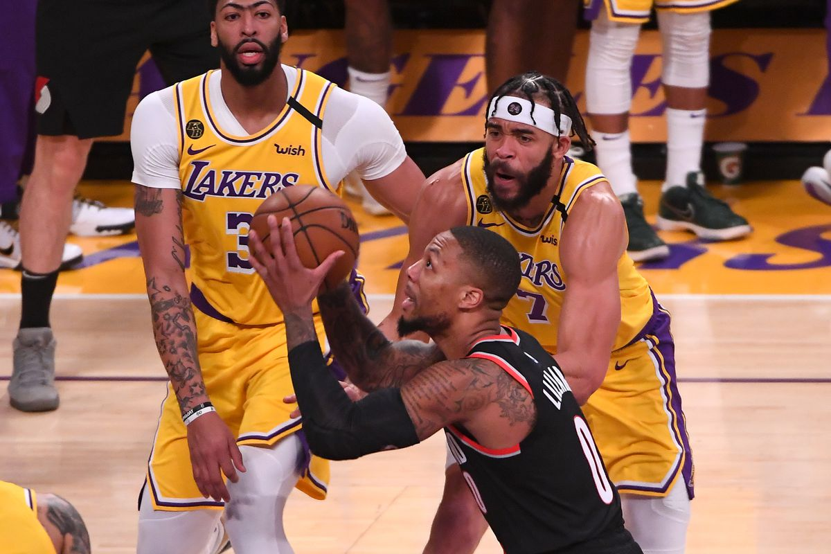 Los Angeles Lakers center JaVale McGee and forward Anthony Davis defend Portland Trail Blazers guard Damian Lillard as he shoots in the second half of the game at Staples Center.