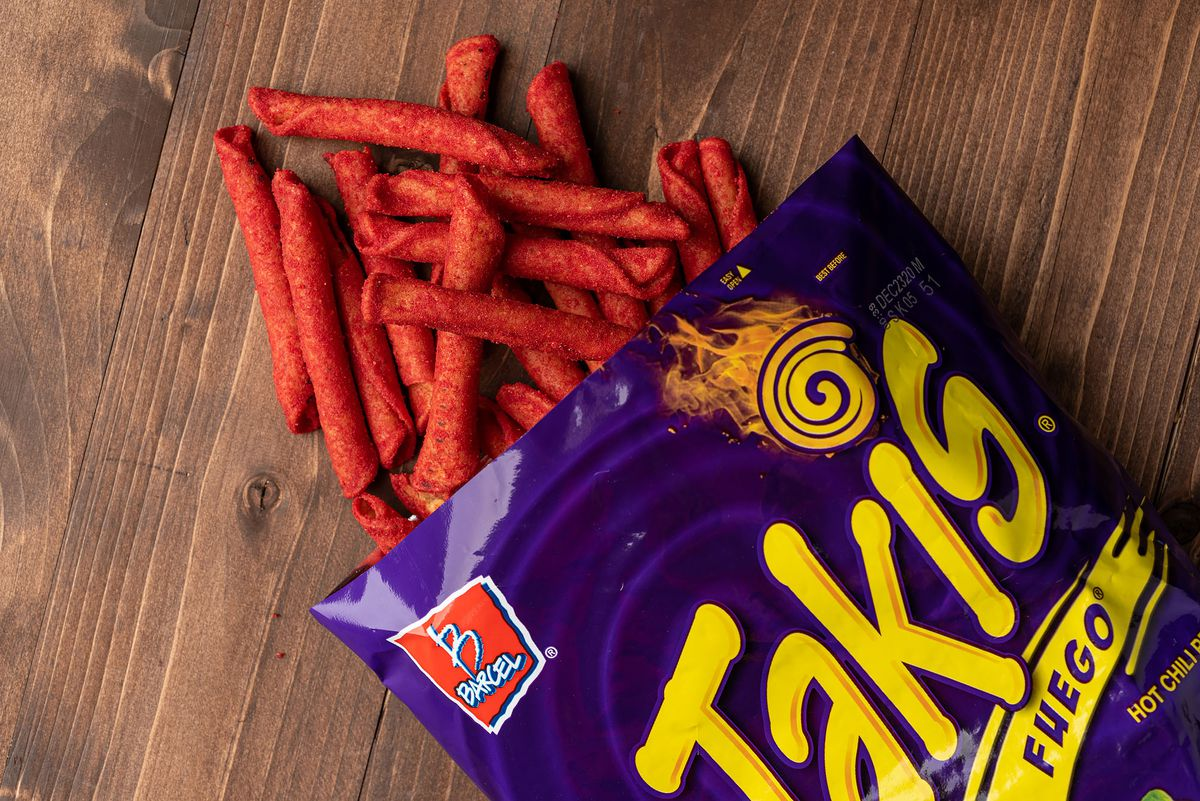 An open bag of Takis with chips spilling out