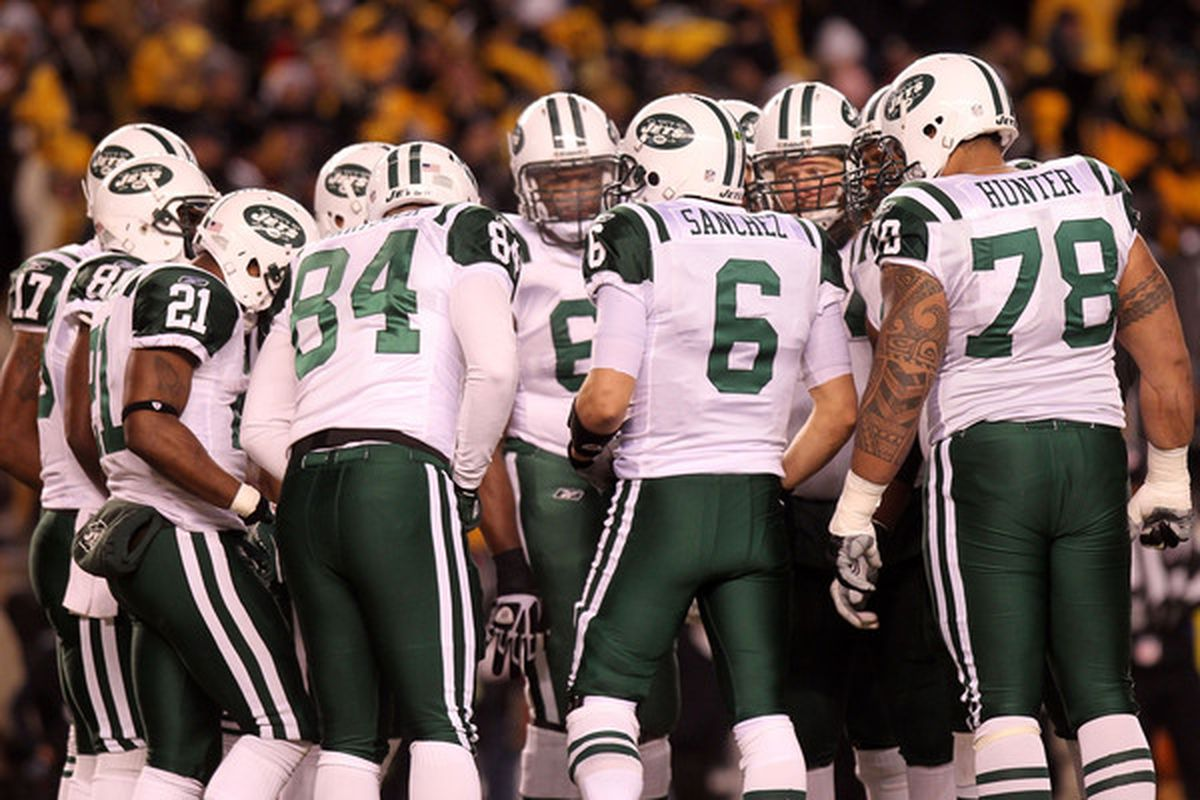 PITTSBURGH PA - JANUARY 23:  The New York Jets huddle around Mark Sanchez #6 during their 2011 AFC Championship game against the Pittsburgh Steelers at Heinz Field on January 23 2011 in Pittsburgh Pennsylvania.  (Photo by Nick Laham/Getty Images)
