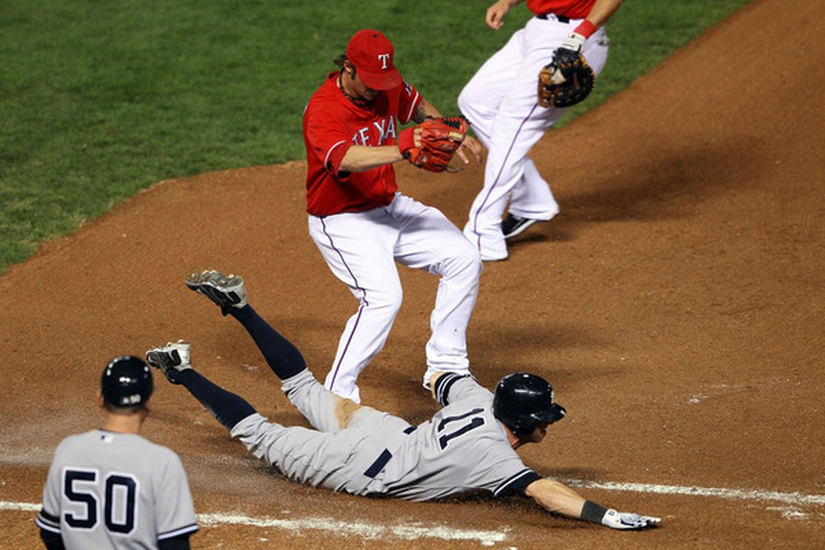 Brett Gardner's head-first dive into first base started the decisive five-run eighth-inning rally for the New York Yankees Friday night in Game 1 of the American League Championship Series. The Yankees won, 6-5.  (Photo by Elsa/Getty Images)