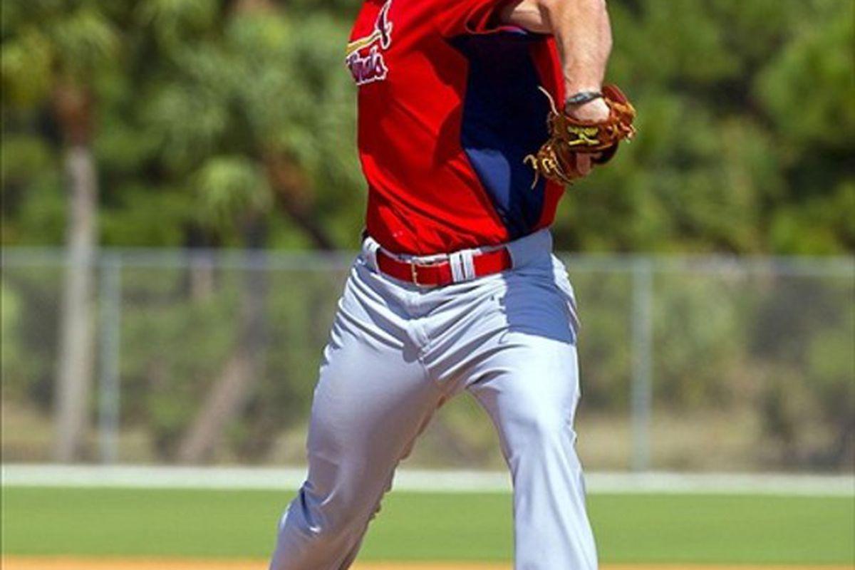 Feb 24, 2012; Jupiter, FL. USA; St. Louis Cardinals starting pitcher Adam Wainwright (50) throws live batting practice during spring training at Roger Dean Stadium. Mandatory Credit: Scott Rovak-US PRESSWIRE