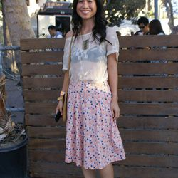 Roberta Liao paired a sheer top with a printed knee-length skirt for sexy meets twee look.