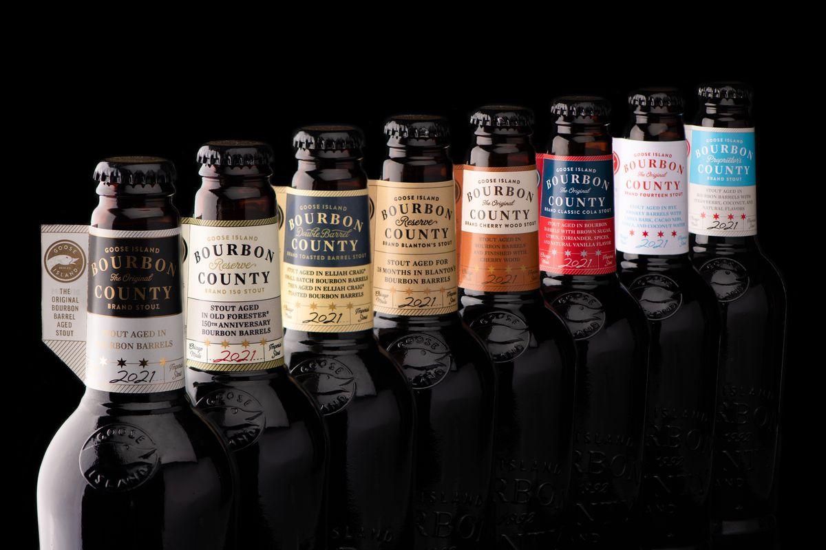 The necks of eight beer bottles.