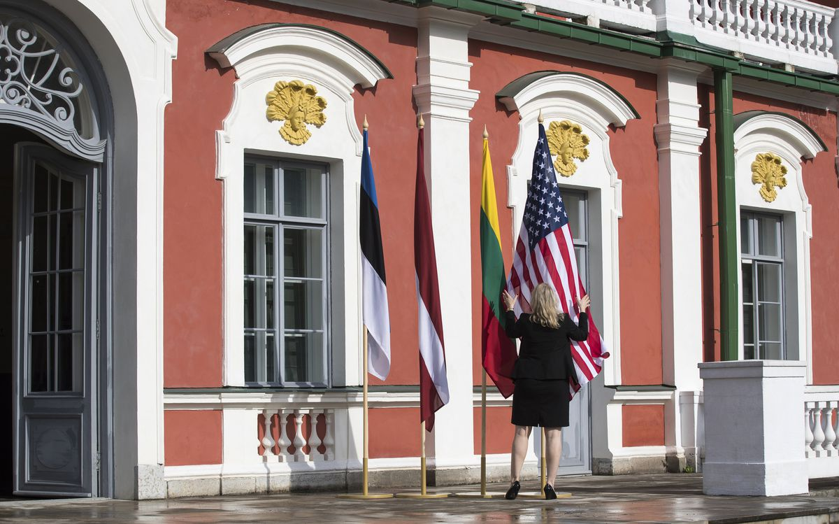 A protocol official sets a flag of the United States and flags of Baltic states (from left) Estonia, Latvia and Lithuania, before the arrival of U.S. Vice President Mike Pence at the Kadriorg Palace in Tallinn, Estonia on Monday. Pence is visiting Estonia