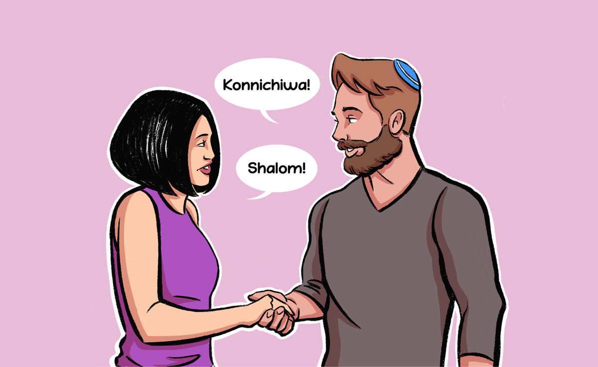 """Illustration of two people shaking hands, one saying, """"Konnichiwa!"""" and the other saying """"Shalom!"""""""