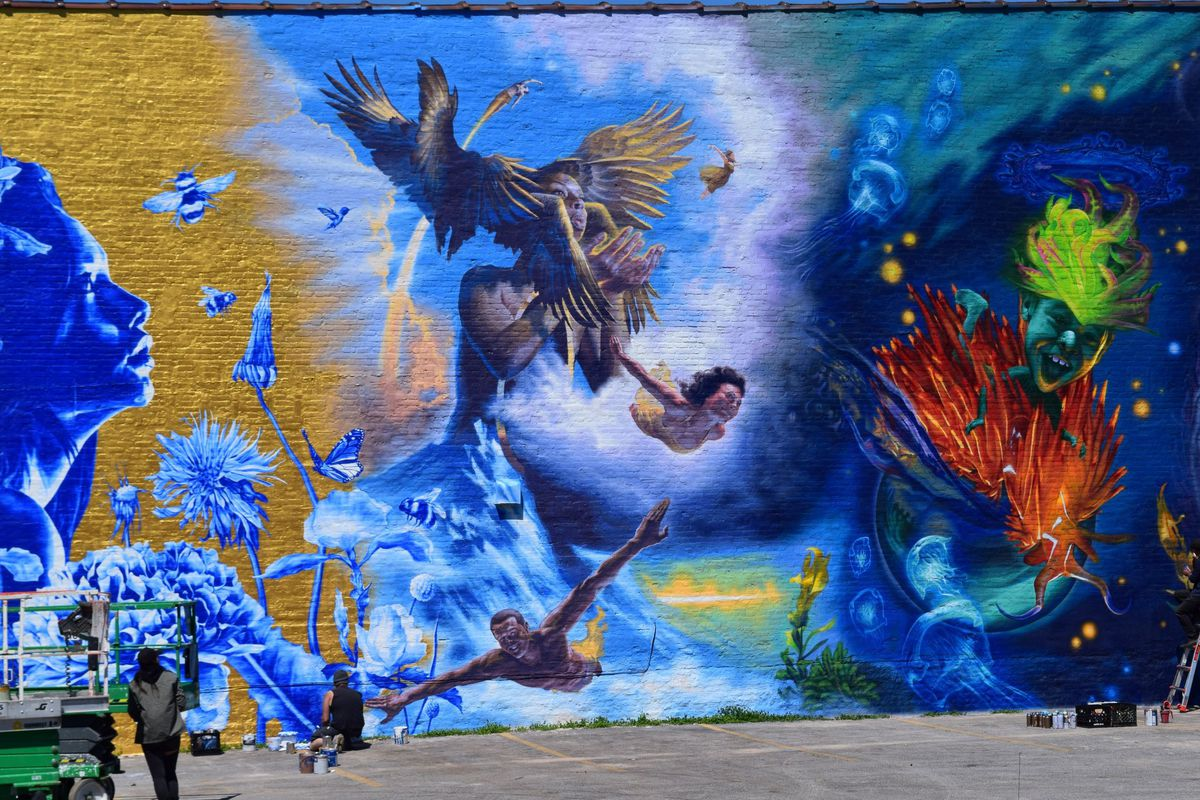 This part of a new South Chicago mural — representing air — was painted by Grigor Eftimov. The figure at the bottom appears to be in flight, with an arm span of 16 feet.