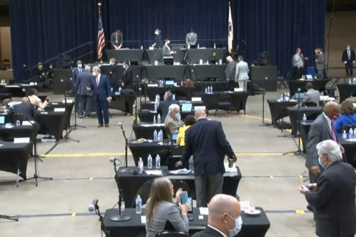 House members prepare for session inside the Bank of Springfield Center on Wednesday.