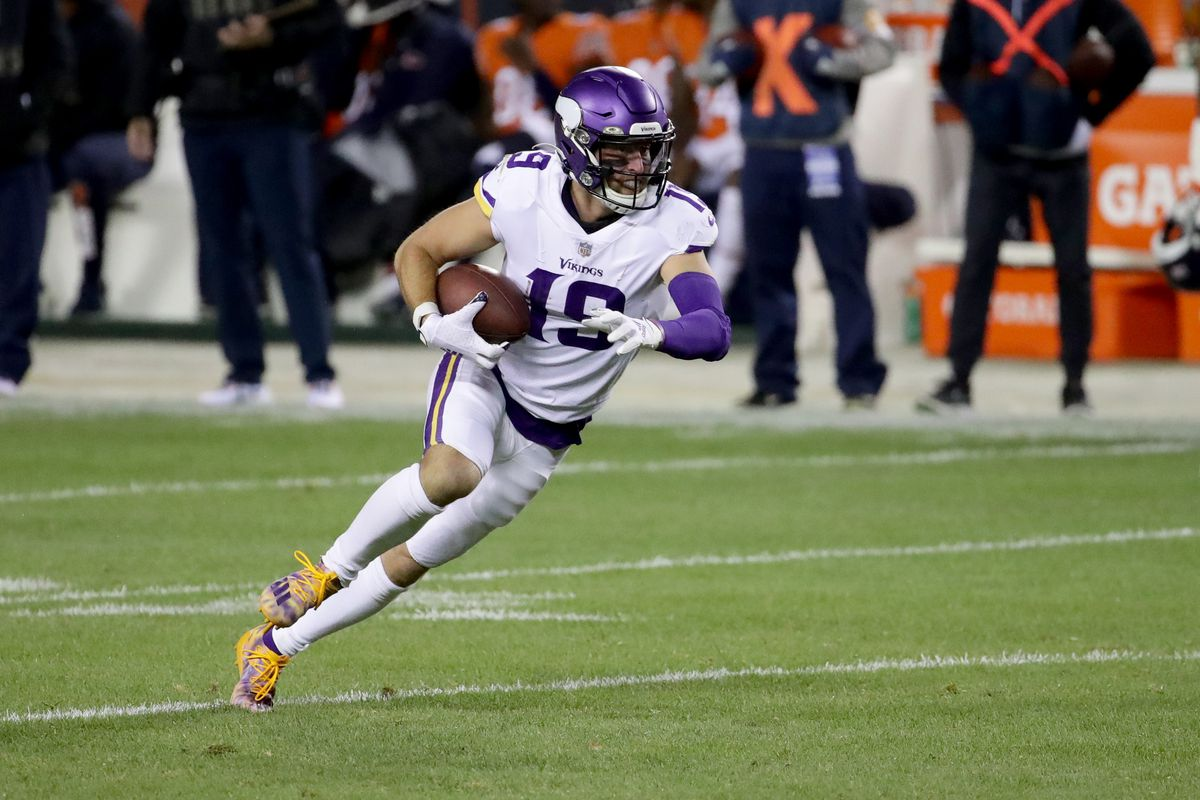 Adam Thielen #19 of the Minnesota Vikings runs with the ball after a pass reception against the Chicago Bears at Soldier Field on November 16, 2020 in Chicago, Illinois.