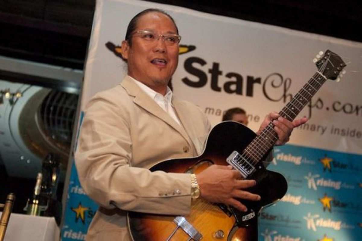 """<b>Masaharu Morimoto</b>: Who knows if Morimoto can actually play that thing, or if some PR person just handed it to him and said: &quot;Quick Morimoto! Rock and Roll!&quot; He's really much better at <a href=""""http://eater.com/archives/2010/09/01/mo"""