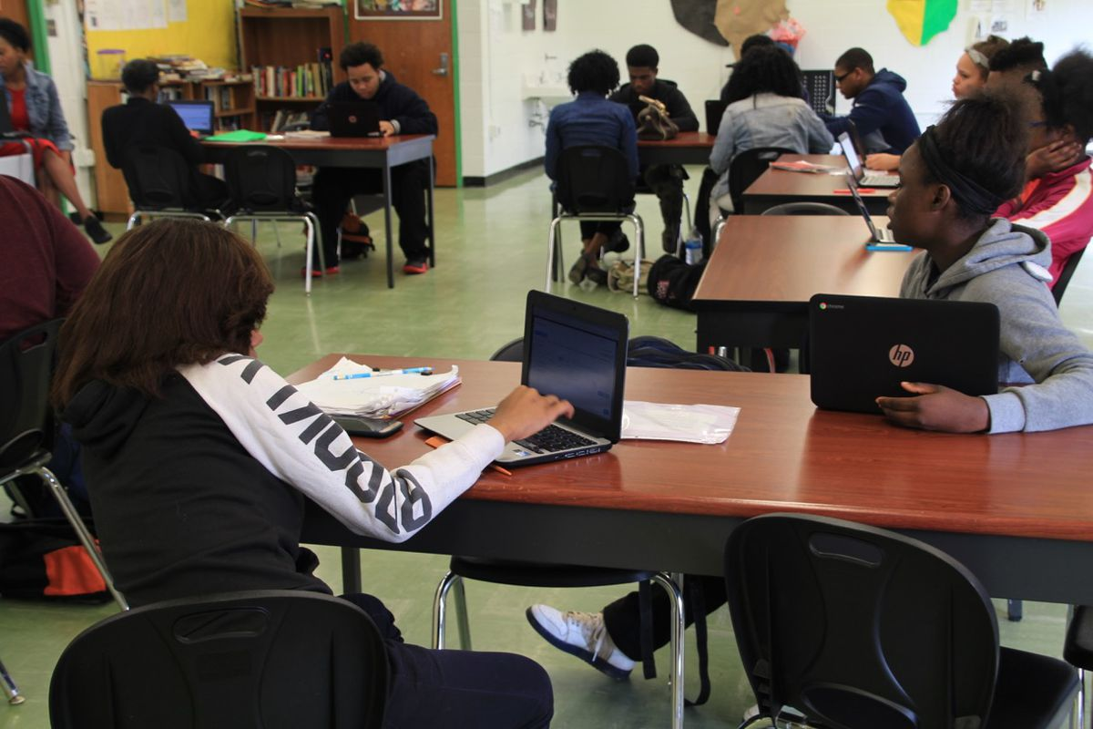 GRAD Academy students work on a writing assignment during an African-American history class. The South Memphis charter school shuttered in 2018.