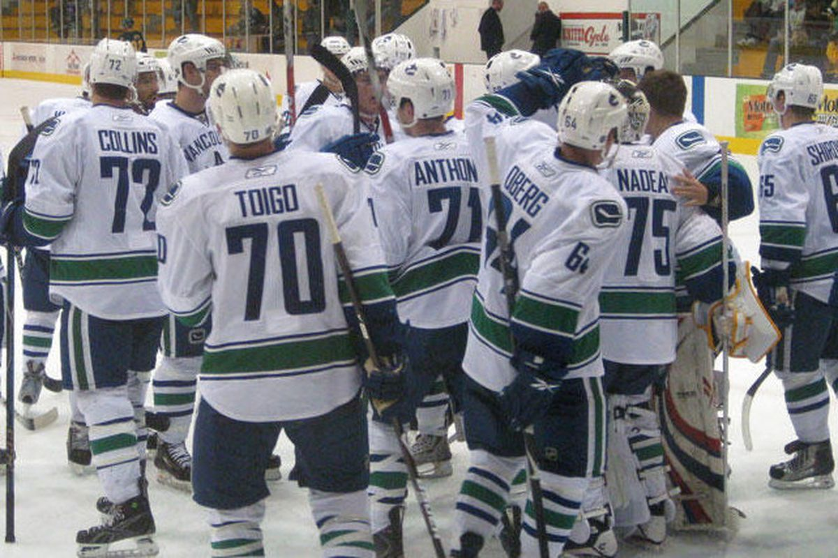 Baby nuckers celebrate their win last night against the University of Alberta Golden Bears. Pic from canucks.com