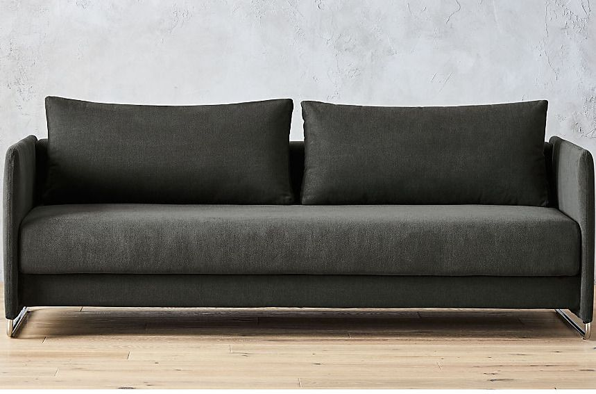 Low-slung charcoal-colored sofa.