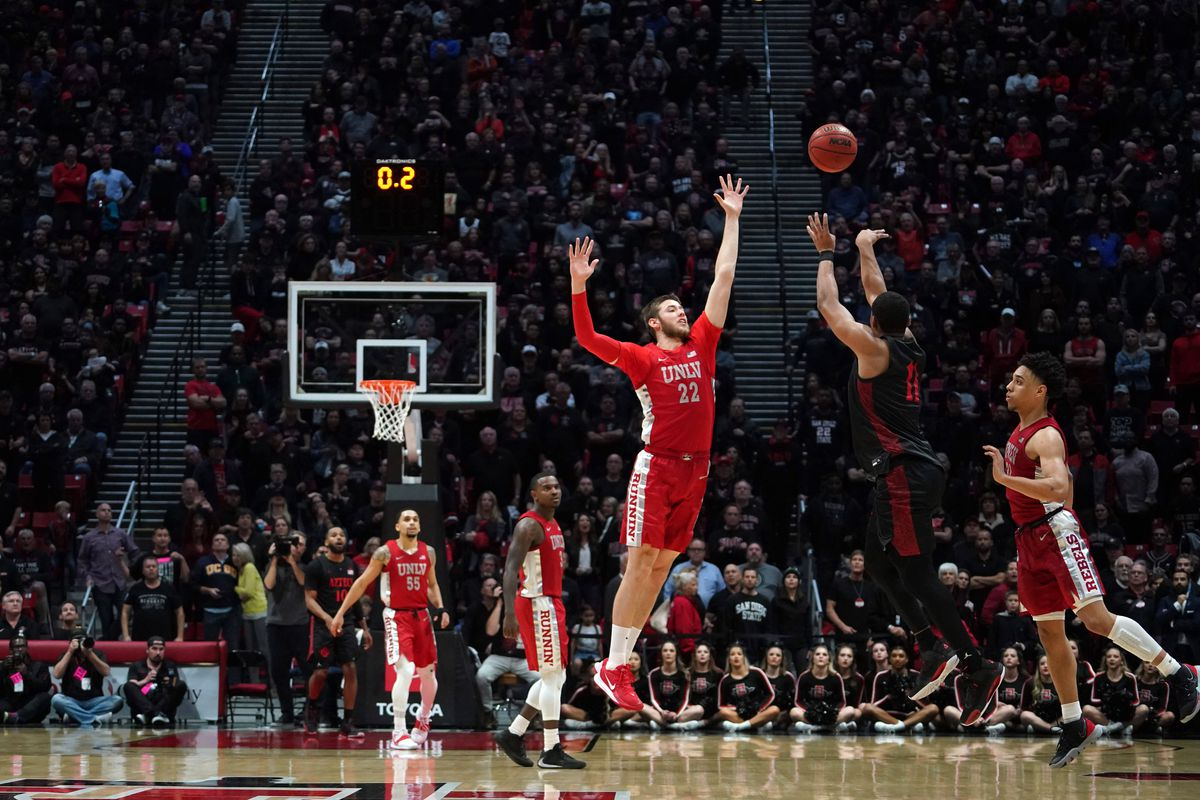 San Diego State Aztecs forward Matt Mitchell attempts a three-point shot in the final second against UNLV Rebels forward Vitaliy Shibel and guard Marvin Coleman at Viejas Arena. UNLV won 66-63.