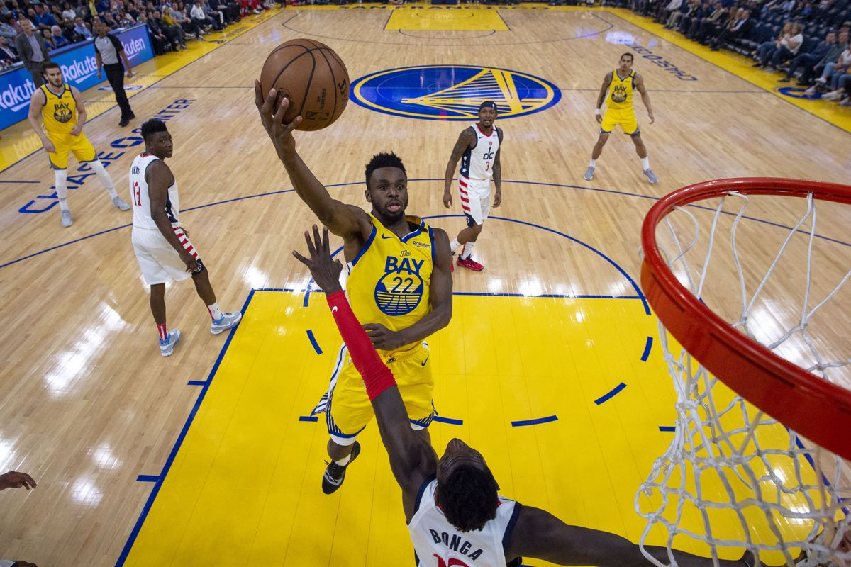 Golden State Warriors guard Andrew Wiggins shoots the basketball against Washington Wizards forward Isaac Bonga during the first half at Chase Center.