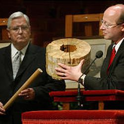Bishop H. David Burton and family history director Richard Turley on Friday show some of the original wooden pieces used in the construction of the Tabernacle as they discuss plans for the seismic upgrades.