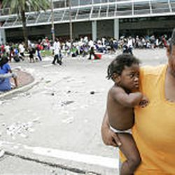 A woman cries as she waits with other flood victims at the Convention Center in New Orleans Thursday. Officials called for a mandatory evacuation of the city, but many residents remained in the city and had to be rescued from flooded homes and hotels and remain in the city awaiting a way out.