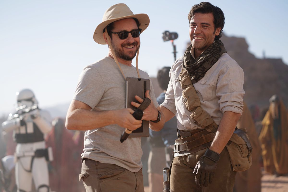 JJ Abrams and Oscar Isaac chuckle on the desert set of Rise of Skywalker